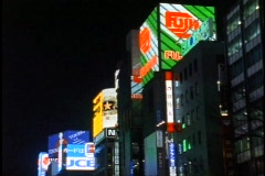Tokyo, The Ginza District at night, neon lights, wide shot, high, signs only Stock Footage
