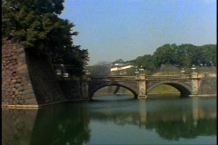 Tokyo, The Imperial Palace, bridge in foreground, wide shot, pan right Stock Footage