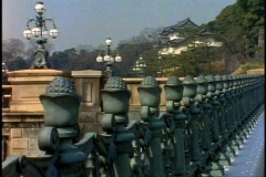 Tokyo, The Imperial Palace, fence spires in foreground, tilt up Stock Footage