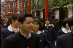 Tokyo, The Asakusa District, arcade, uniformed teenage school students Stock Footage