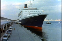 The Queen Elizabeth 2, QE2 at the Yokohama Pier alongside, from the bow Stock Footage