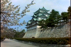 Nagoya Castle, cherry blossoms in foreground, very wide shot Stock Footage