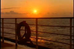 The Queen Elizabeth 2, QE2 sunset at sea, medium shot rails, buoy - stock footage