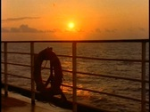 Stock Video Footage of The Queen Elizabeth 2, QE2 sunset at sea, medium shot rails, buoy