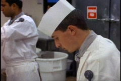 The Queen Elizabeth 2, QE2 galley, close-up slicing and laying out pate Stock Footage