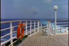 The Queen Elizabeth 2 stern from the railings and aft deck. Stock Footage