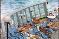 The Queen Elizabeth 2, QE2 deck, crowd in deck chairs sunning Stock Footage