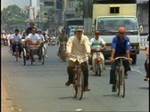 Stock Video Footage of Ho Chi Minh City, Saigon traffic, Motor scooters, cyclos, buses