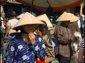Stock Video Footage of Ho Chi Minh City, Saigon Market, medium close-up, faces, conical hats