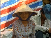 Stock Video Footage of Ho Chi Minh City, Saigon Market, close-up of woman in conical hat