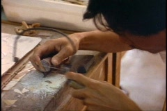 Ho Chi Minh City, lacquer ware making, close-up sawing Stock Footage