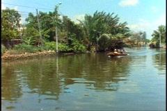 Boat ride through canals (klongs) of Bangkok, POV, medium shot, pass boat Stock Footage