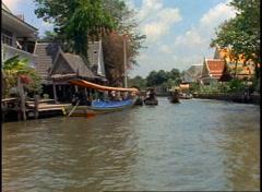 Boat ride through canals (klongs) of Bangkok,  POV, passing long boat Stock Footage