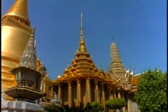 Royal Palace of Bangkok, medium shot details, gilt, spires Stock Footage
