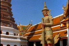 Royal Palace of Bangkok, medium shot dragon monkey god statue, pan right Stock Footage