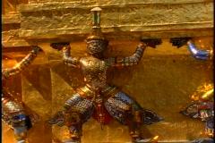 Royal Palace of Bangkok, gilt monkey statues, pan right, very gaudy Stock Footage