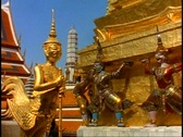 Stock Video Footage of Royal Palace of Bangkok, gilt details, goddess and monkeys, medium close up