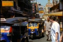 Bangkok Tuk tuks (small 3 wheel taxis),  medium close up still Stock Footage