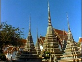 Stock Video Footage of Temple of the Reclining Buddha, wide shot spires, pan right