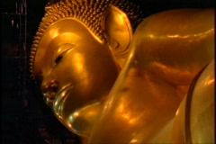 Temple of the Reclining Buddha, The Golden Buddha, close up face of gold Stock Footage