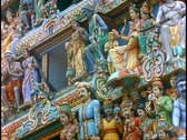 Stock Video Footage of Hindu Temple, colorful gods and goddesses, medium close up, tilt down