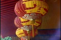 Singapore, close up red paper lanterns enveloped in smoke at temple Stock Footage
