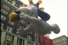 New York Thanksgiving Day Parade, Snoopy Balloon passing overhead Stock Footage