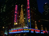 Radio City Music Hall at Christmas, nighttime with traffic, crowds, marquee Stock Footage