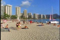 Waikiki Beach and Diamond Head, people on the beach in Honolulu Stock Footage