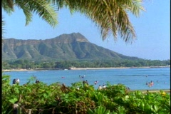 Diamond Head alone surrounded by green foliage, from Waikiki in Honolulu Stock Footage