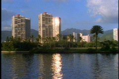 Honolulu Apartments on Alawai Canal, glint of sunlight at magic hour Stock Footage