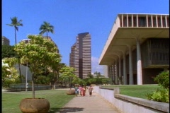 The Hawaii State Capital Building, wide shot, people walk, in Honolulu Stock Footage