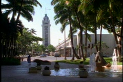 The Aloha Tower, with traffic and a  fountain in Honolulu Stock Footage