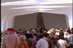 The USS Arizona Memorial at Pearl Harbor with people inside Stock Footage