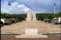 The Punchbowl Cemetery above Honolulu in Hawaii, stairs and statue Stock Footage