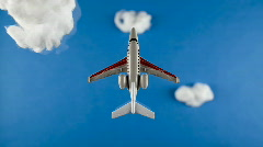 Stop Motion Model aeroplane flying through clouds/ studio shot Stock Footage