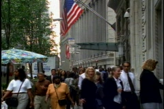 New York City, Wall Street, people, sidewalk, flags Stock Footage