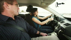 Father teaching daughter to drive - stock footage