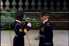 Two guards examining rifle, very stylized, medium shot Stock Footage