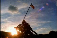Iwo Jima Memorial, wide shot silhouette against setting sun Stock Footage