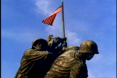 Iwo Jima Memorial, close up, low flag and faces Stock Footage