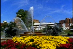 Kansas City Country Club Plaza, fountain, medium shot, with flowers Stock Footage