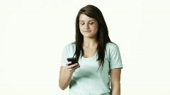 Portrait of young woman text-messaging against white background Orem Stock Footage