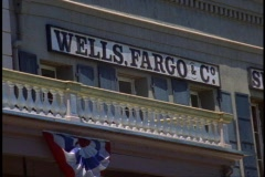 """Old Town"" Sacramento, close up Wells Fargo sign with bunting Stock Footage"
