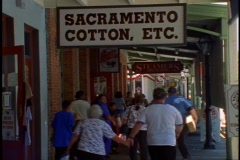 """Old Town"" Sacramento, medium shot, signs, people on wooden sidewalk Stock Footage"