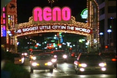 Reno by Night, medium close up, traffic under the arch Stock Footage