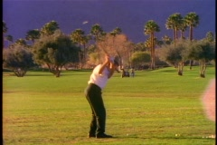 Golf course, Palm Springs, man teeing off Stock Footage