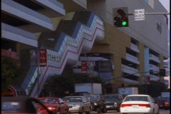 Beverly Center shopping mall in Los Angeles, with traffic, escalators on side Stock Footage