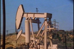 Oil rigs pumping oil - stock footage
