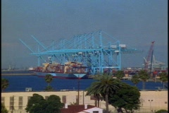 Passing shipping cranes in Los Angles Harbor, POV Stock Footage